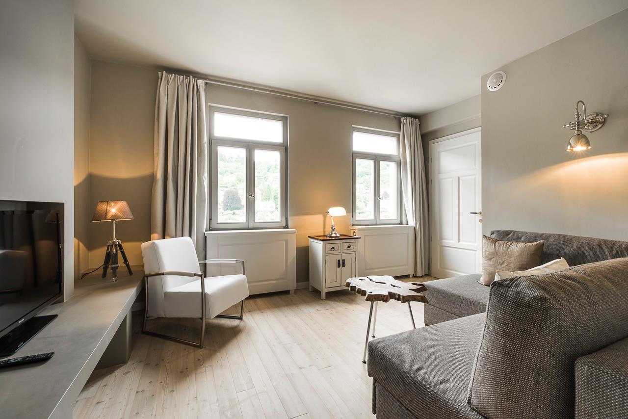 Boardinghouse - Wohnbereich mit Sessel - Inneneinrichtung Heidelberg, Mannheim, Stuttgart - Gaffga Interieur Design. Planung und Ausführung - Lichtplanung - Möbel auf Maß. Boardinghouse
