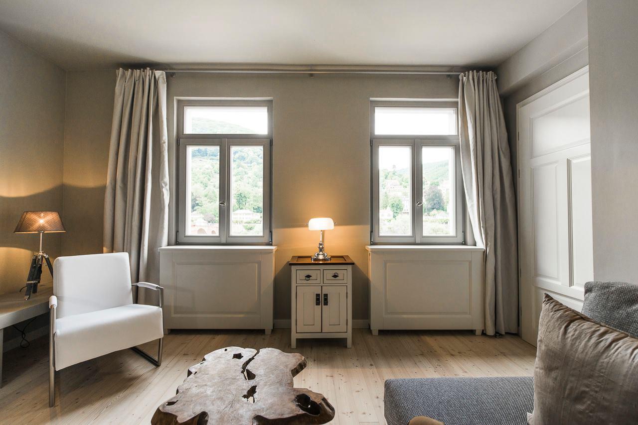 Boardinghouse Wohnbereich Blick zum Fenster - Inneneinrichtung Heidelberg, Mannheim, Stuttgart - Gaffga Interieur Design. Planung und Ausführung - Lichtplanung - Möbel auf Maß. Boardinghouse